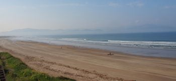 surf at the beautiful inch beach in county kerry